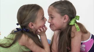 8 Year Old Twins Giggle at Each Other
