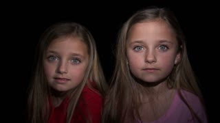 8 Year Old Twins Staring at Camera