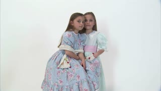 8 Year Old Twins Whisper then Look at Camera