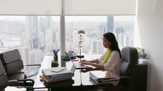 9 Business Woman Secretary Typing Fast On Laptop In Office