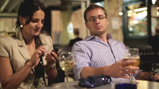 Couple drinks beer in evening at restaurant
