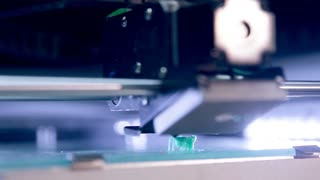 A 3D printer builds a shape