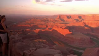 A Couple Watches The Sunrise At Dead Horse Point State Park Utah