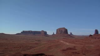 A Cowboy On His Horse Overlooks Monument Valley