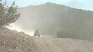 A Series Of Four Wheelers On Dusty Roads