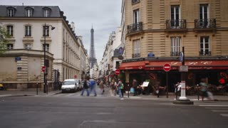 A view of the Eiffel Tower from one of the many streets of Paris, France, Europe - T/Lapse