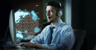 A young man,who work in office with computer graphic, in a world appears on the screen with a augmented reality.Concept: customer care,worldwide service and futuristic and immersive technologyv
