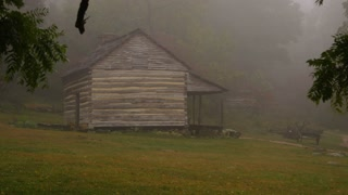 Log cabin in the foggy woods 2