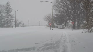 Snow Plows Driving Through Washington DC During Winter Blizzard