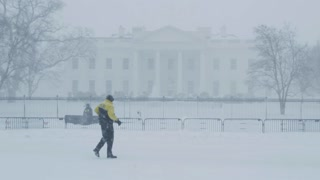 Secret Service in front of Snowy White House in Washington DC Winter Blizzard Wide 2