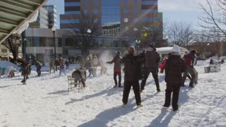 Group Snowball Fight in City Winter