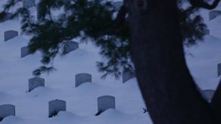 Snow Covered Arlington Cemetery in Winter Close Pan Left
