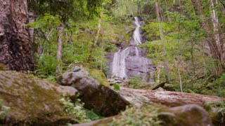 Waterfall in lush woods of Great Smoky Mountains National Park forest slider right slow