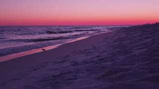 Vibrant beach sunset in Destin Florida dolly slider left