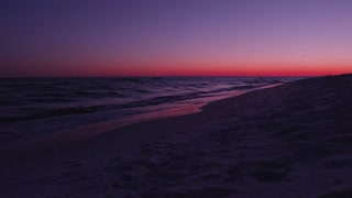 Deep purple sunset in Destin Florida dolly slider left