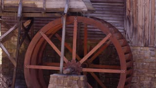 Close up on a grail mill powered by water