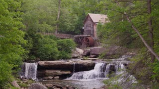 Summer evening shot of a beautiful grain water mill in the forest - Glade Creek Grist Mill in Babcock State Park West Virginia