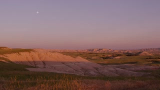 Sunset in Badlands National Park with moon