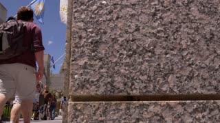 Mount Rushmore Slider Shot through tourists visiting Mt. Rushmore