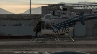 Actor Emerges From Helicopter While Crew Films