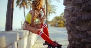Adorable Roller Skate Girl Sitting at Beach