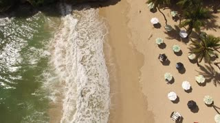 Aerial Across Beach With Crashing Waves And Sand Paradise Vacation