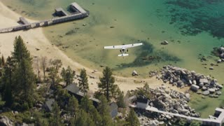 Aerial Air To Air Of Plane Flying Over Lake Tahoe 2