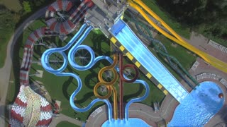 AERIAL: Big extreme waterpark with water slides and pools