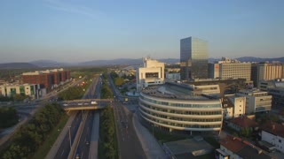 AERIAL: Contemporary business district at summer sunset