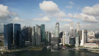 Aerial daylight view over Central Singapore and Marina Bay, Singapore, South East Asia, Time lapse