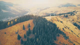 Aerial Drone Footage: Turn right and 180 degree shooting of autumn mountains with forests, meadows and hills in sunset soft light. Carpathian Mountains, Ukraine, Europe. Majestic landscape. Beauty