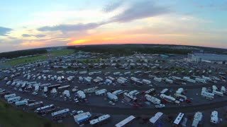 aerial drone over trailers parked at stadium event