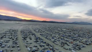 Aerial drone shot of Burning Man festival 2016 at sunset in Black Rock Desert, Nevada