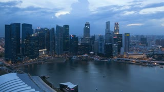 Aerial dusk to night view over Central Singapore and Marina Bay, Singapore, South East Asia, Time lapse
