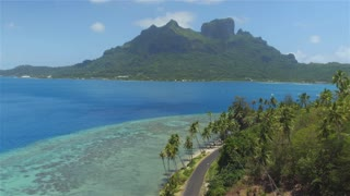 AERIAL: Flying above beautiful Bora Bora island with blue lagoon