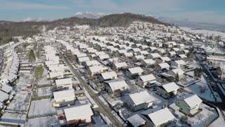 AERIAL: Flying above suburban houses in winter