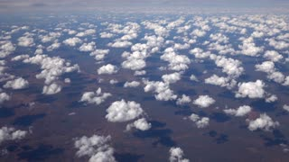 AERIAL: Flying high above white clouds and amazing Great Victoria Desert