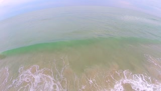 Aerial Flyout From Ocean Tide