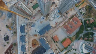 Aerial footage shot over a modern construction site in urban setting