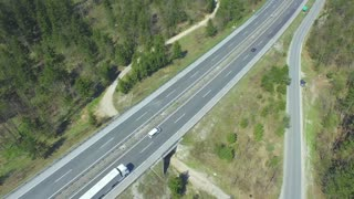 AERIAL: Freight truck transporting cargo container on a highway