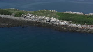 Aerial Glide Over Rocky Island Outcrop In Boston Harbor