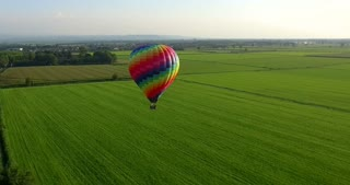Aerial image of a hot air balloon that travels free in the sky full of colors in the green of nature. concept of life, liberty and happiness and travel.