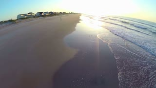 Aerial of Bright Sunrise on Beach