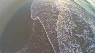 Aerial of Sunrise Tide Rolling onto Beach