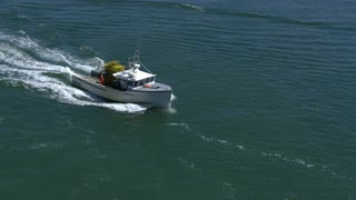 Aerial Pan Around Fishing Boat With Cargo In Boston Harbor