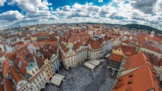 aerial panoramic view of Old Town Square neighborhood timelapse in Prague from the top of the town hall. Cloudy sky at summer day. Fisheye lens