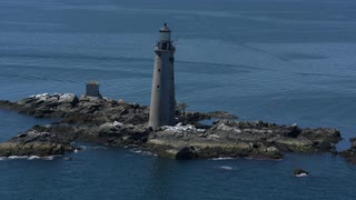 Aerial Pull Out Centering On Lighthouse Erected On Rocky Islet, Boston Harbor