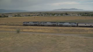 Aerial Shot Of Amtrak Train And Desert Town