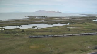 Aerial Shot Of Amtrak Train And Great Salt Lake