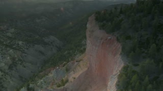 Aerial Shot Of Bryce Canyon National Park Circling A Forested Cliff